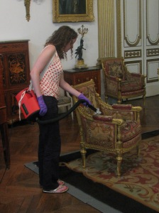 Curatorial Assistant Rosie cleaning the Van den Bergh suite