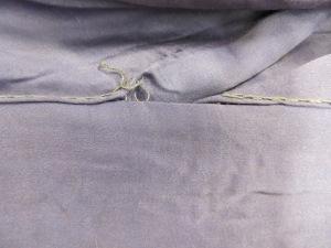 Loose stitching on seams