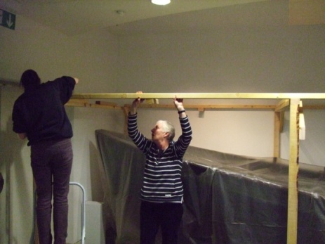 Virginia Mayes-Wright (Museum Manager) and Kirsty Watts (Visitor services assistant) building the frame