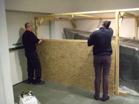 Jim Donaldson (Carpenter) and Virginia installing the first side of the box