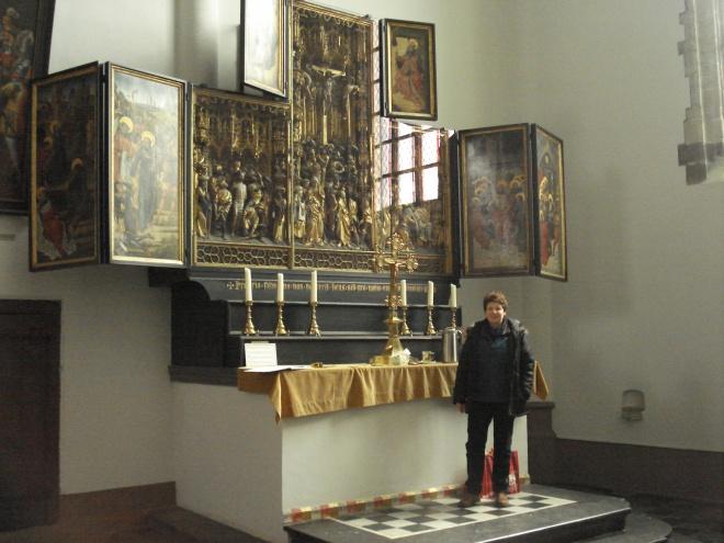 Frie Van Ravensteyn in front of the Geel AltarpieceFrie Van Ravensteyn in front of the Geel Altarpiece