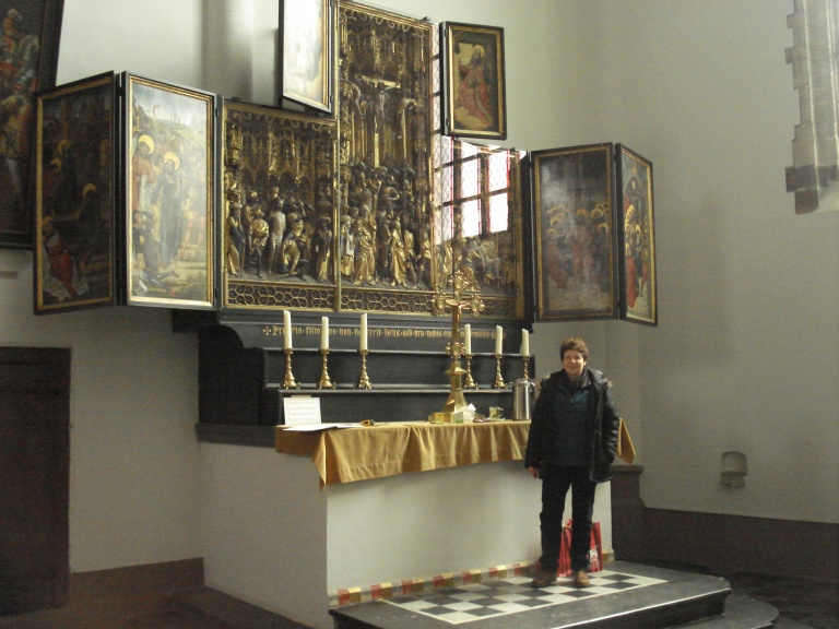 Frie Van Ravensteyn in front of the Geel AltarpieceFrie Van Ravensteyn in front of the Geel Altarpiece