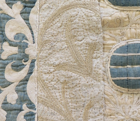 Close-up of valance showing three different embroideries which have been pieced together