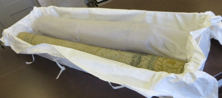 Coverlet rolled and re-packed into a Tyvek® lined custom-made box and covered in acid-free tissue