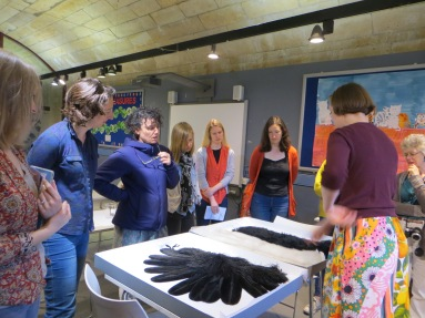 Katy Smith, Textile conservator, showing some of the feathers objects from The Bowes Museum collection