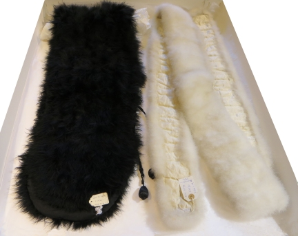 CST.1420 Woman's short cape made of ostrich feathers and eleven large black feathers mounted and sewn on to black crepe-de-chene.