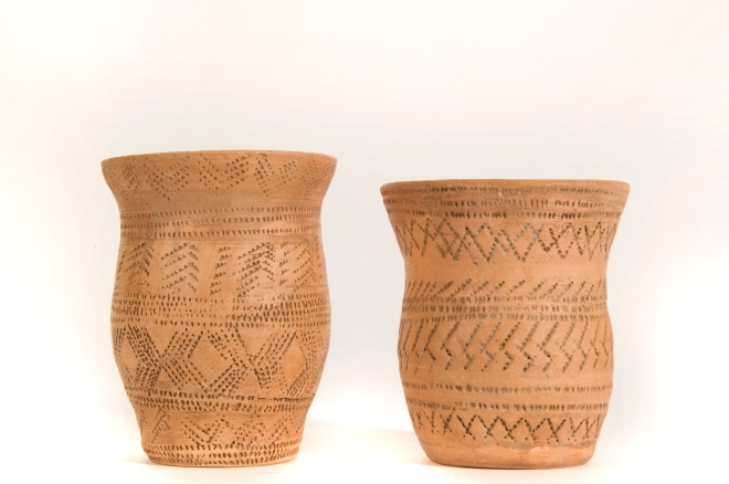 Neolithic and Bronze Age pots were made by rolling long coils of clay which were then laid on top of each other and smoothed over to create the tall sides of the vessel. They were decorated by making marks in the clay using bones, sticks and even fingernails!