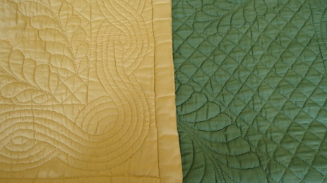 Single wholecloth quilt in cotton, one side yellow, the other green (not cat)
