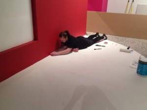 Charlotte masking the stage in the YSL exhibition, ready for the painter to come back
