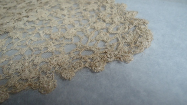 Detail, showing underside of lace collar, with net support stitched in position