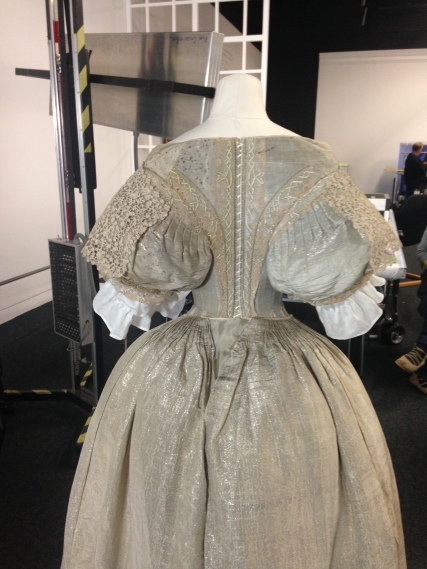 View of the back of the dress, with the lace collar secured over the shoulders