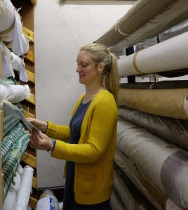 Kate in one of the rolled textile stores