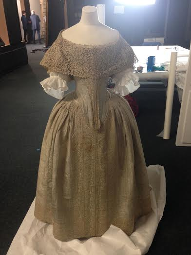 Lace collar in position on silver tissue dress