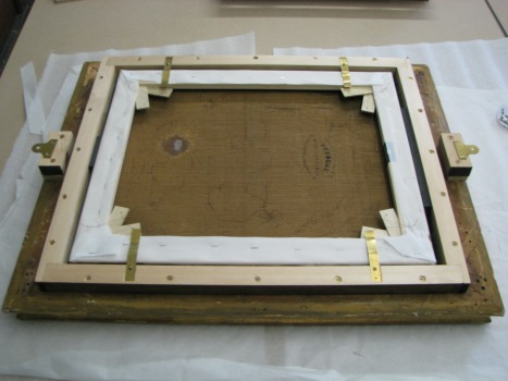 13 - Painting fitted in frame with brass mending plates..