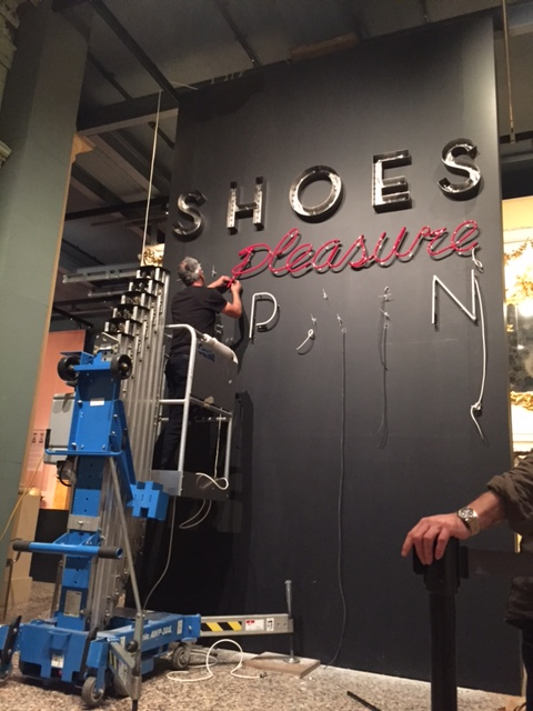 Neon sign being installed