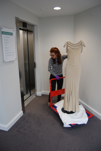 Schiaparelli dress [CST.2.60] being transported to the showcase
