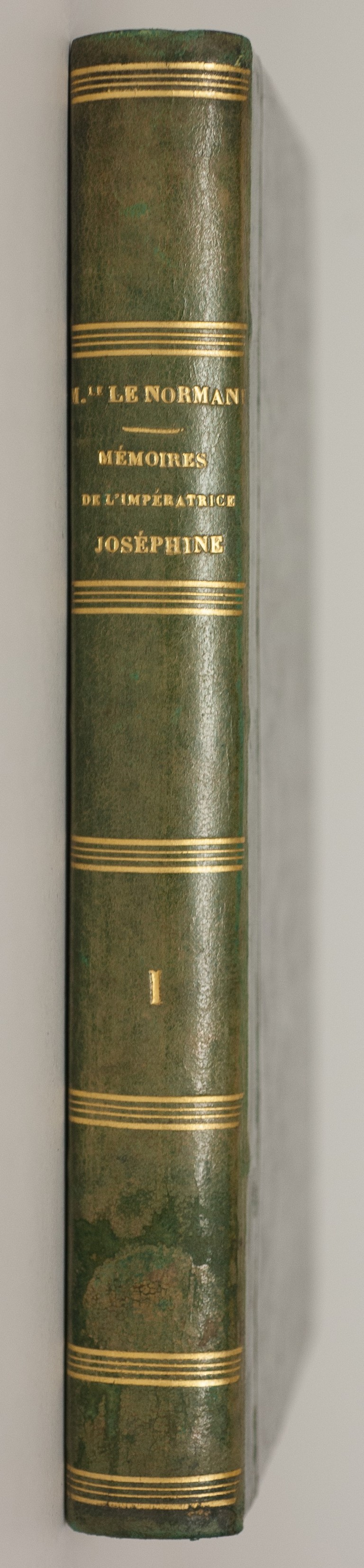 Spine and inside front cover of the first volume of Marie-Anne Lenormand's 'Mémoires historiques et secrets de l'Impératrice Joséphine', held in the Bowes archive