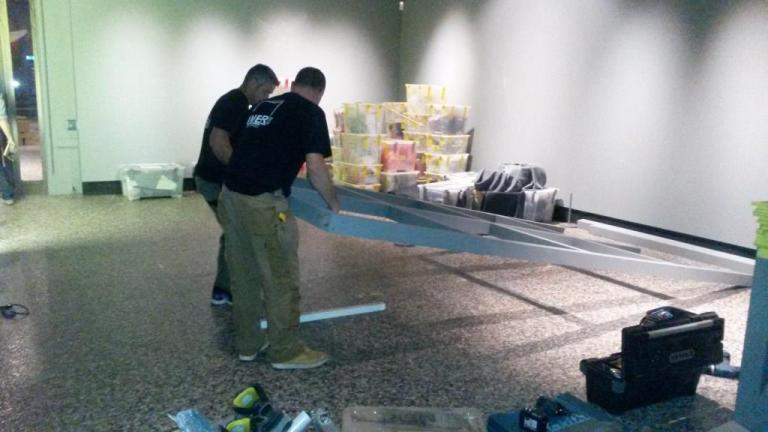 MER Services installing the backboards to the shelves