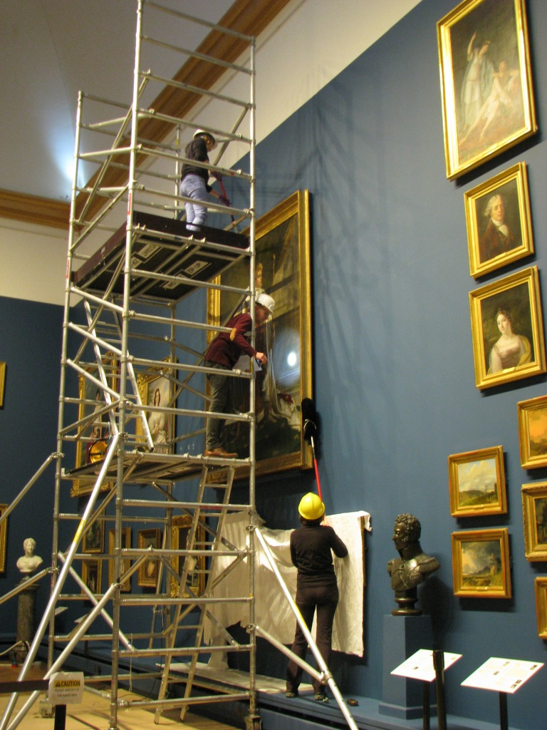 Joint effort to clean Napoleon in the gallery